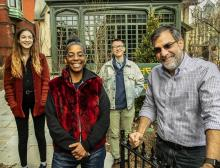 (from left) sophomore Sophia DuRose, Professor Simone White, graduate student Davis Knittle, and Writers House Director Al Filreis in front of the Kelly Writers House.