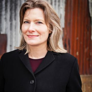 Jennifer Egan in black coat