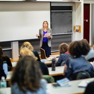 Jennifer Egan lectures from front of classroom
