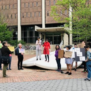 Over two dozen students, faculty, and local residents gathered on Monday in front of the Button with signs supporting Penn Book Center